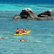 Kids snorkeling and kayaking with family in Andaman sea, Ko Lipe, Thailand