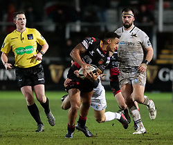 Dragons' Ashton Hewitt is tackled by Ospreys' Tom Habberfield<br /> <br /> Photographer Simon King/Replay Images<br /> <br /> Guinness Pro14 Round 12 - Dragons v Cardiff Blues - Sunday 31st December 2017 - Rodney Parade - Newport<br /> <br /> World Copyright © 2017 Replay Images. All rights reserved. info@replayimages.co.uk - http://replayimages.co.uk