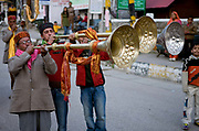 Three men play large horn instrueents at a musical and religious celebration in Manali on 27th October 2009, Himachal Pradesh, India.