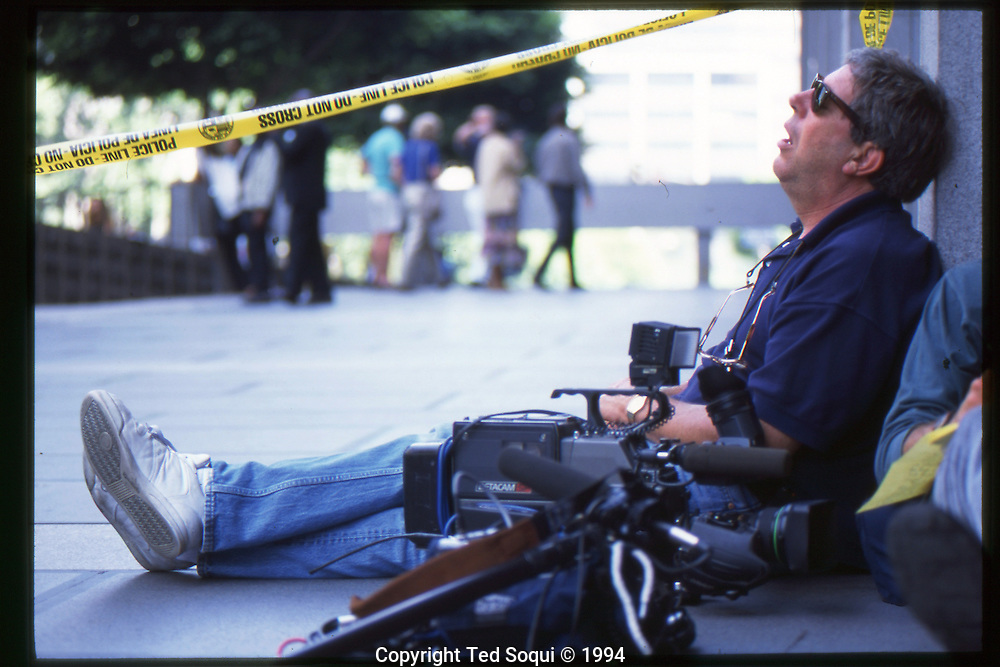 The OJ Simpson trial and media circus.<br /> A sleeping media member outside the Criminal Courthouse.