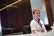 Receptionist in the British Airways Galleries First .for First Class passengers at Heathrow airport's terminal 5.