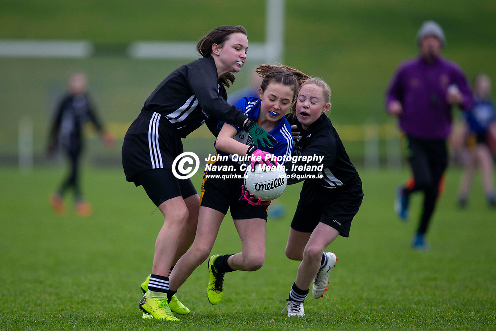 23/11/2019, Cumann na mBunscol Primary School Finals at Pairc Tailteann, Navan<br /> Game 2: Girls Division 2 Football Final Kilcloon N.S. vs Lismullen N.S.<br /> Lauren Mooney (Kilcloon NS) & Ava Darby / Nicole Clarke (Lismullen NS)<br /> Photo: David Mullen / www.quirke.ie ©John Quirke Photography, Unit 17, Blackcastle Shopping Cte. Navan. Co. Meath. 046-9079044 / 087-2579454.<br /> ISO: 1600; Shutter: 1/1250; Aperture: 3.5; <br /> File Size: 3.0MB