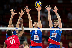06.09.2014, Jahrhunderthalle, Breslau, POL, Venezuela vs Serbien, Gruppe A, im Bild Kervin Pinerua venezuela #10 Nikola Jovovic serbia #9 Marko Podrascanin serbia #18 Uros Kovacevic serbia #2 // during the FIVB Volleyball Men's World Championships Pool A Match beween Uenezuela and Serbia at the Jahrhunderthalle in Breslau, Poland on 2014/09/06. <br /> <br /> ***NETHERLANDS ONLY***