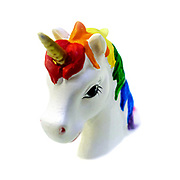 Colourful  unicorn toy with golden horn on white