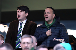 Irish Taoiseach Leo Varadkar (right) in the stands singing the national anthem during the Guinness Six Nations match at the Aviva Stadium, Dublin.