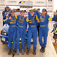Cody Crocker, Greg Foletta, Dean Herridge and Glenn MacNeal celebrate their 1st and 3rd place .Podium.2003 Rally of Canberra .Canberra, ACT, Australia.25-27th of April 2003.(C) Joel Strickland Photographics