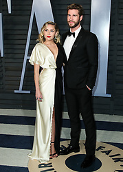BEVERLY HILLS, LOS ANGELES, CA, USA - MARCH 04: 2018 Vanity Fair Oscar Party held at the Wallis Annenberg Center for the Performing Arts on March 4, 2018 in Beverly Hills, Los Angeles, California, United States. 04 Mar 2018 Pictured: Miley Cyrus, Liam Hemsworth. Photo credit: IPA/MEGA TheMegaAgency.com +1 888 505 6342
