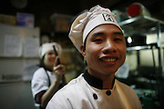 "Hanoi, Vietnam. March 11th 2007..The cook of the restaurant ""Xa Lo 4""."