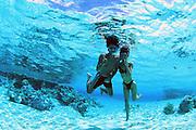 Snorkeling couple, Rangiroa, French Polynesia