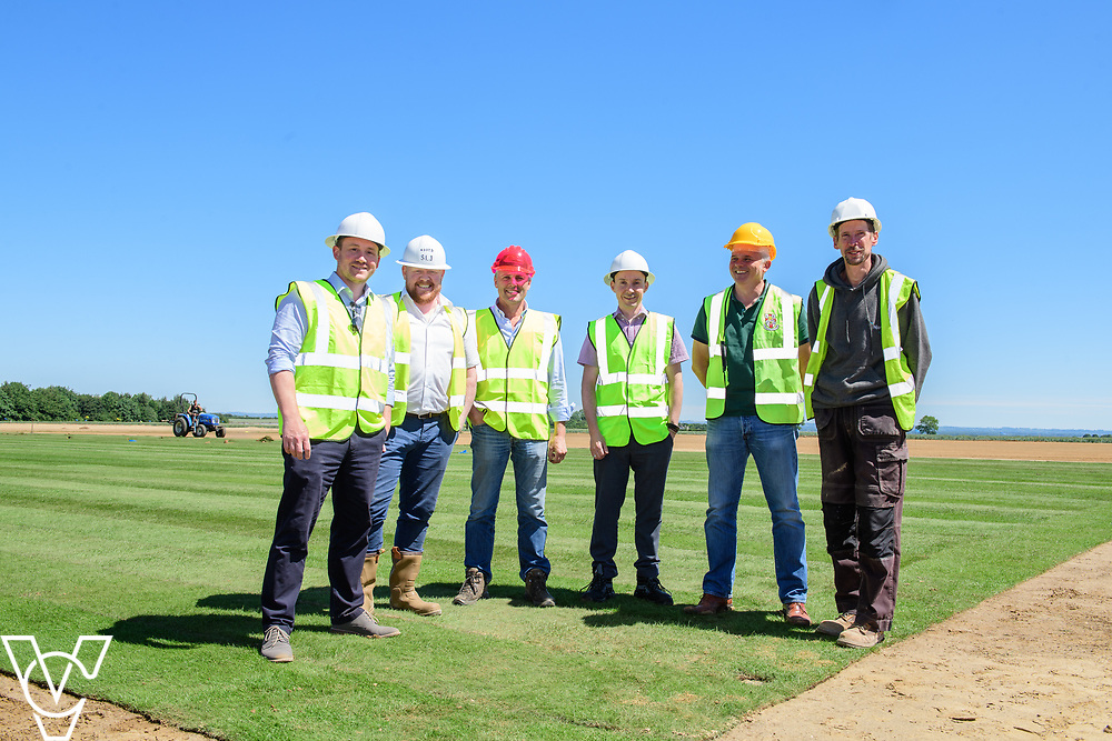 Work has been progressing on Lincoln City's new training ground in Scampton, near Lincoln.  Pictured from left, Oliver Fytche-Taylor (West Lindsey District Council's head of planning), Steve Jones (Njord Design & Build managing director), Andrew Ward MBE (project consultant), Ian Elliott (West Lindsey District Council's senior development management officer), Darren Curtis (Lincoln City operations manager/safety officer) and John Guest (Njord Design & Build project manager).<br /> <br /> Picture: Chris Vaughan Photography for Lincoln City<br /> Date: June 22, 2018