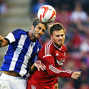 Markel Bergara (left) and David Goodwillie during the Europa League third qualifying round second leg soccer match between Aberdeen and Real Sociedad at Pittodrie Stadium in Aberdeen, Britain, 07 August 2014. EPA/ROBERT PERRY