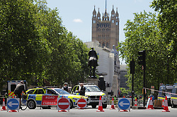 © Licensed to London News Pictures. 13/06/2020. London, UK. Police officers form a blockade on Whitehall ahead of planned demonstrations. Protests have taken place across the United States and in cities around the world in response to the killing of George Floyd by police officers in Minneapolis on 25 May. Photo credit: Rob Pinney/LNP