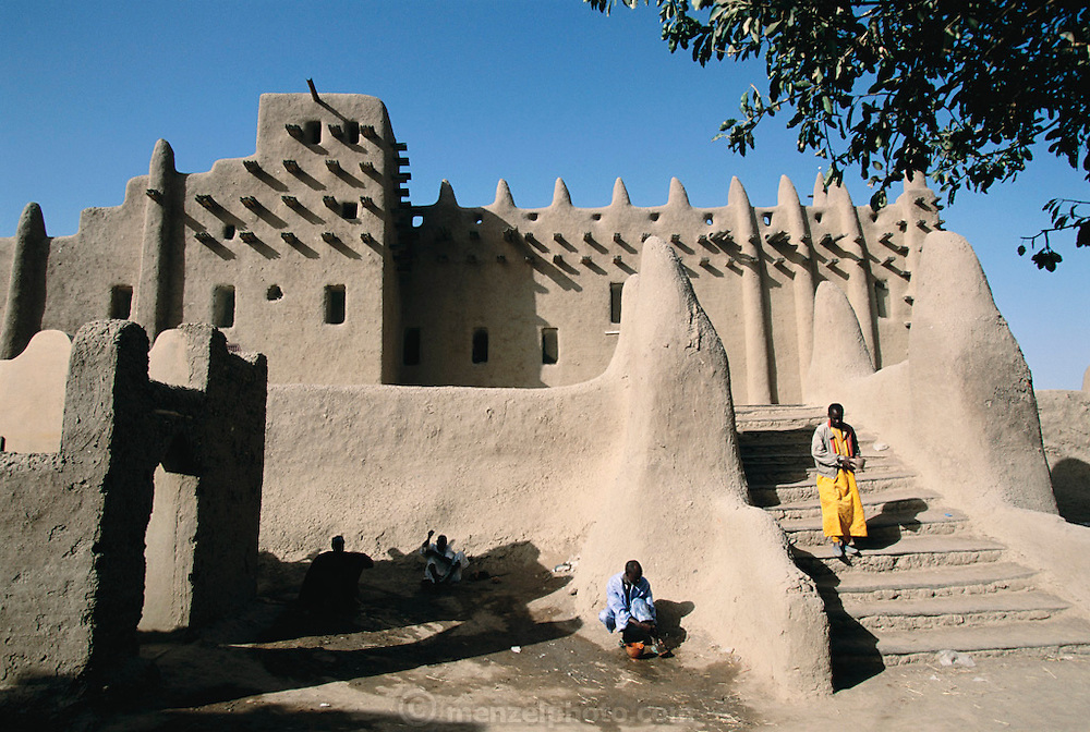 Worshipers perform ritual washing before prayers at the Grand Mosque in Djenne, Mali. Africa.