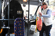 Israel, Tel Aviv, Interior of a city bus woman boards the bus