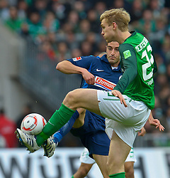 16.10.2010, Weser Stadion, Bremen, GER, 1.FBL, Werder Bremen vs SC Freiburg. im Bild  Per Mertesacker ( Werder #29 ) Naximilian Nicu ( Freiburg #10 )   EXPA Pictures © 2010, PhotoCredit: EXPA/ nph/  Kokenge+++++ ATTENTION - OUT OF GER +++++