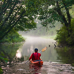 A man kayaks the Indian Head River in Hanover, Massachusetts.