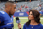 New York Giants running back Rashad Jennings (23) does a post game interview with 23 CBS Sports sideline reporter Jenny Dell after the NFL week 3 regular season football game against the Houston Texans on Sunday, Sept. 21, 2014 in East Rutherford, N.J. The Giants won the game 30-17. ©Paul Anthony Spinelli