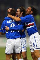 Genova 13/3/2004 CAMPIONATO ITALIANO SERIE A - <br /> 25a giornata - Matchday 25 <br /> Sampdora Bologna 3-2 <br /> Fabio Bazzani Cristiano Doni e  Morris Carrozzieri (Sampdoria) festeggiano il 3-1 per la Sampdoria<br /> Cristiano Doni (center) and  Morris Carrozzieri (right) (Sampdoria) celebrate Fabio Bazzani (left) for his assist for Cipriani that scored 3-1 for Sampdoria<br /> Photo Andrea Staccioli Graffiti