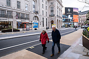 Elderly prople out and about on Regent Street in a scene of empty desolation as the national coronavirus lockdown three continues on 29th January 2021 in London, United Kingdom. Following the surge in cases over the Winter including a new UK variant of Covid-19, this nationwide lockdown advises all citizens to follow the message to stay at home, protect the NHS and save lives.