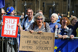 "© Licensed to London News Pictures. 04/009/2019. London, UK. ""Stop the Coup"" protesters with a placard demonstrates outside Parliament. On Monday 3 Sept 2019, MP's voted by 328 -301 with a majority of 27 to take control of the House of Commons agenda for Tuesday 4 Sept 2019. Photo credit: Dinendra Haria/LNP"