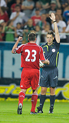 Grenchen, Switzerland - Tuesday, July 17, 2007: Liverpool's Jamie Carragher and referee against SV Werder Bremen during a pre-season friendly at Stadion Bruhl. (Photo by David Rawcliffe/Propaganda)