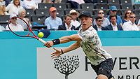 Tennis - 2019 Queen's Club Fever-Tree Championships - Day Three, Wednesday<br /> <br /> Men's Singles, First Round: Juan Martin Del Potro (ARG) Vs. Denis Shapovalov (CAN)<br /> <br /> Denis Shapovalov (CAN) stretches to reach the ball on Centre Court.<br />  <br /> COLORSPORT/DANIEL BEARHAM