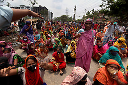 April 18, 2020, Dhaka, Bangladesh: People block a road as they demand relief during a government imposed lockdown amid corona virus epidemic in Dhaka, Bangladesh on Saturday, Apr. 18, 2020. (Credit Image: © Syed Mahamudur Rahman/NurPhoto via ZUMA Press)