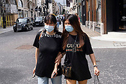 As the national coronavirus lockdown three eases towards the planned Freedom Day in just over two weeks, people, many of whom are still wearing face masks while out on the street, come to Bond Street shopping district on 3rd July 2021 in London, United Kingdom. Now that the roadmap for coming out of the national lockdown and easing of restrictions is set, dome medical professionals are suggesting thatsome safety measures are kept in place because of the increase in the Delta variant.