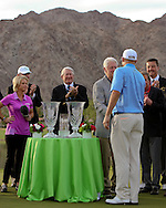 """22 JAN 15  Champion Bill Haas accepts congratulations from The 42nd President of the United States, William Jefferson Clinton on the 18th green at the conclusion of Sunday""""s Final Round at The Humana Challenge at PGA West, in LaQuinta, California.(photo credit : kenneth e. dennis/kendennisphoto.com)"""