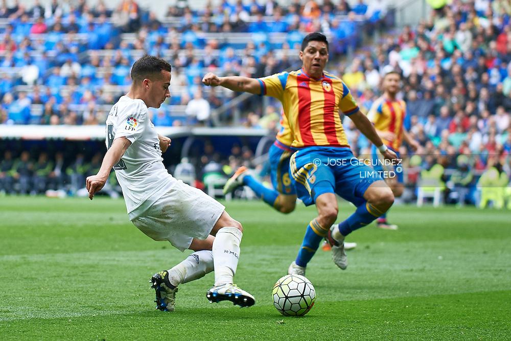 Lucas Vazquez (midfielder; Real Madrid), Antonio Barragan (defender; Valencia) in action during La Liga match between Real Madrid and Valencia at Santiago Bernabeu on May 8, 2016 in Madrid