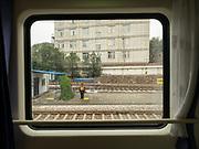 Leaving the Lanzhou train station. Window view across China, from Hong Kong to Urumqi, Xinjiang.