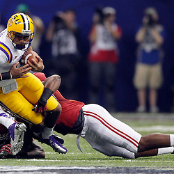 Jan 9, 2012; New Orleans, LA, USA; LSU Tigers quarterback Jordan Jefferson (9) is tackled by Alabama Crimson Tide linebacker Jerrell Harris (5) during the first half of the 2012 BCS National Championship game at the Mercedes-Benz Superdome.  Mandatory Credit: Derick E. Hingle-US PRESSWIRE