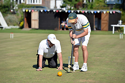 © Licensed to London News Pictures. 14/08/2013. Surbiton, UK. Jeff Newcombe, Australia in action. People participate in the14th World Association Croquet Championship at the Surbiton Croquet Club, Kingston upon Thames on the 14th August 2013. The Final will be played on Sunday 18th August. 80 competitors from 20 countries are taking part. Photo credit : Mike King/LNP