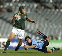 Photo: Richard Lane.<br />South Africa v Uruguay, Pool C at the Subiaco Oval, Perth. RWC 2003. 11/10/2003. <br />De Wet Barry goes past Sebastian Aguirre.