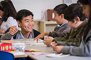 James Lee works with his fourth grade students at Crespo Elementary School, April 21, 2014.