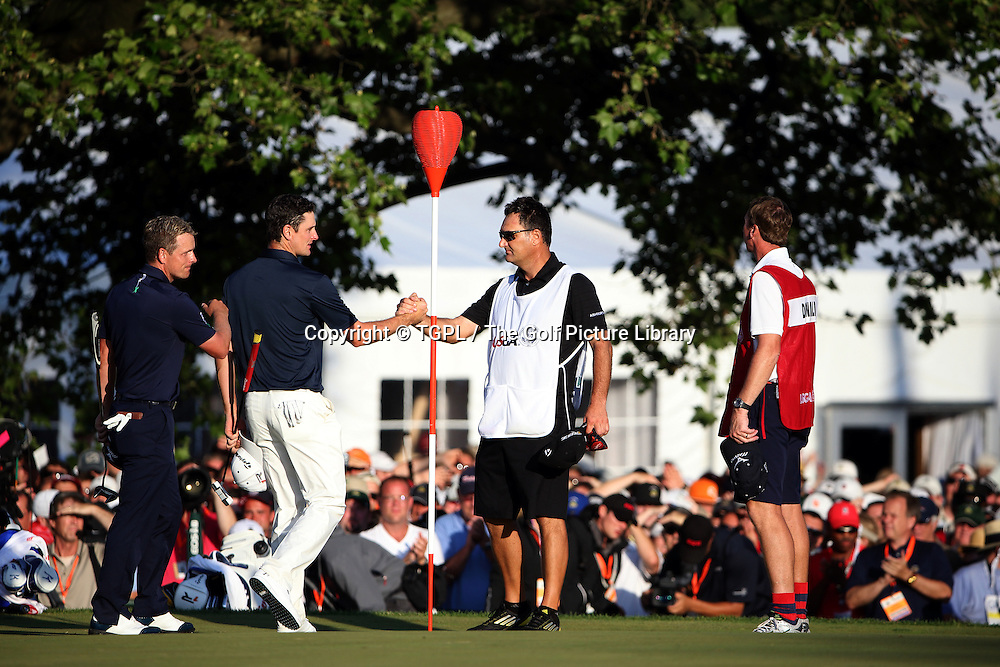 Justin ROSE (ENG) wins and shoes hands with his caddie Furch during fourth round  US Open Championship 2013,Merion,East Course,Ardmore,PA,USA.