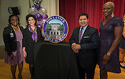 Felicia Adams, Elyse Lanier, Houston ISD Superintendent Richard Carranza and Trustee Jolanda Jones pose for a photograph with a marker during a renaming ceremony at Bob Lanier Middle School, September 21, 2016.