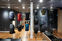 The interior of the ARC'TERYX store in Victoria features high ceilings, natural finishes and effective lighting to showcase the sports clothing.