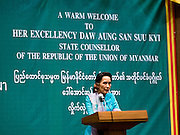 23 JUNE 2016 - MAHACHAI, SAMUT SAKHON, THAILAND: AUNG SAN SUU KYI speaks to a crowd of about 250 Burmese migrant workers hand selected to attend her community meeting during a visit to the Burmese community in Samut Sakhon, a province south of Bangkok. Tens of thousands of Burmese migrant workers, most employed in the Thai fishing industry, live in Samut Sakhon. Aung San Suu Kyi, the Foreign Minister and State Counsellor for the government of Myanmar (a role similar to that of Prime Minister or a head of government), is on a state visit to Thailand. Even though she and her party won the 2015 elections by a landslide, she is constitutionally prohibited from becoming the President due to a clause in the constitution as her late husband and children are foreign citizens        PHOTO BY JACK KURTZ
