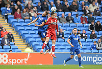 Middlesbrough's Martin Payero and Cardiff City's Will Vaulks challenge for the header <br /> <br /> Photographer Ian Cook/CameraSport<br /> <br /> The EFL Sky Bet Championship - Cardiff City v Middlesbrough - Saturday 23rd October 2021 - Cardiff City Stadium - Cardiff<br /> <br /> World Copyright © 2020 CameraSport. All rights reserved. 43 Linden Ave. Countesthorpe. Leicester. England. LE8 5PG - Tel: +44 (0) 116 277 4147 - admin@camerasport.com - www.camerasport.com