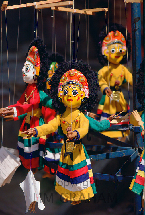 Brightly colored wooden carved puppets-on-strings on sale in the market in Bhaktapur, Nepal