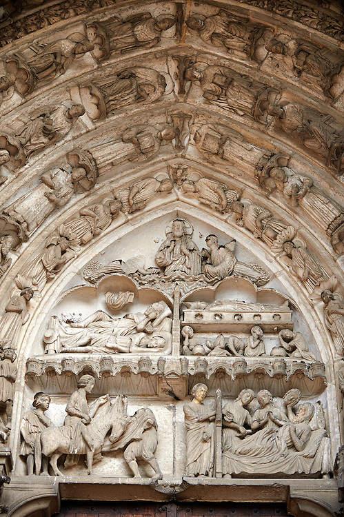 South Porch, Right Portal, Tympanum- General View.This portal is dedicated to the Confessors. Cathedral of Chartres, France. Tympanum and Lintel: Miracles by two very popular saints, Martin and Nicholas, are shown on the tympanum and lintel. Both saints have figures on the jambs below and several windows in the interior lower level and clerestory..On the left is the Miracle of Martin's cloak. In the lower left panel, Martin, a young Roman stationed in Amiens, met a beggar at the city gate one cold day. Moved by the man's suffering, Martin cut his cloak in half and gave him one of the pieces. In the upper left panel, Martin is shown sleeping. His dream is shown on the tympanum; Christ appears wearing the piece of the cloak he gave to the beggar, who had really been Christ..On the right are miracles of Nicholas. In the bottom panel, Nicholas anonymously gives dowries to three indigent girls. On the upper right, pilgrims at Nicholas's tomb, which supposedly gave off a miraculous healing fluid. .Archivolts: .On the lower register of archivolts are miracles of Gilles, including the Mass of St. Gilles (right). The other archivolts show various Confessors.A UNESCO World Heritage Site. .<br /> <br /> Visit our MEDIEVAL ART PHOTO COLLECTIONS for more   photos  to download or buy as prints https://funkystock.photoshelter.com/gallery-collection/Medieval-Middle-Ages-Art-Artefacts-Antiquities-Pictures-Images-of/C0000YpKXiAHnG2k