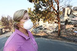 October 13, 2017 - Napa, California, U.S. - MAUREEN QUINN surveys the damage to her Silverado Highlands home on Friday morning. She said she came one last time to see what was left of her home, which was destroyed in the Atlas Fire. (Credit Image: © Napa Valley Register via ZUMA Wire)