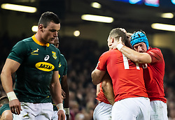 Liam Williams of Wales celebrates scoring his sides second try with team-mate Justin Tipuric<br /> <br /> Photographer Simon King/Replay Images<br /> <br /> Under Armour Series - Wales v South Africa - Saturday 24th November 2018 - Principality Stadium - Cardiff<br /> <br /> World Copyright © Replay Images . All rights reserved. info@replayimages.co.uk - http://replayimages.co.uk