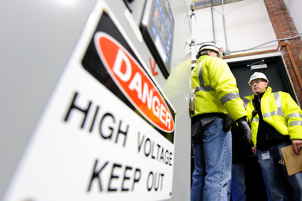 Genzyme Sanofi facilities employees updating electric panels.