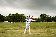 12 SEPTEMBER 2020 - DES MOINES, IOWA: RONAN ROCK, 11, dressed as Star Wars Imperial Storm Trooper while he helped his mom park cars during the Polk County Democrats Steak Fry at Waterworks Park in Des Moines. The Steak Fry is the largest fundraiser of the year for Polk County Democrats. The Steak Fry observed public health guidelines. This year nearly 1,000 people attended. Normally the Steak Fry is a picnic but this year people stayed in their cars while meals were brought to them and they wore masks when they were outside of the cars. Most of the speakers appeared via online speeches.     PHOTO BY JACK KURTZ