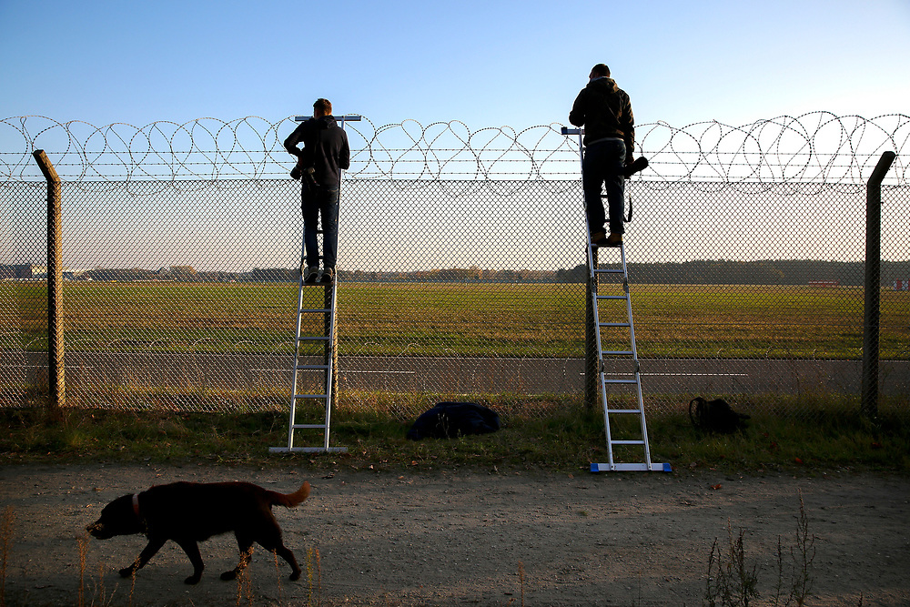 Proffesional plane-spotters wait on the fence at Tegel Airport (TXL) to witness the final departure made from the historic airport, Berlin, Germany, November 8, 2020. After more than 60 years Berlin's tiny northern airport is set to shut down all operations, with a final departure flight by AirFrance to Paris. (Photos by Omer Messinger)