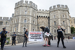 A bandaged giant pigeon is used by PETA activists to protest against pigeon racing outside Windsor Castle on 1 July 2020 in Windsor, United Kingdom. Animal rights charity PETA UK is calling on the Queen, who is currently isolating at Windsor Castle, to cut ties with pigeon racing following a PETA US investigation which revealed that all eight birds sent by the Queen to participate in the 2020 South African Million Dollar Pigeon Race (SAMDPR) died in quarantine and that fewer than a quarter of the birds entered for the race subsequently complete it.