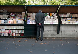 Book stalls on pavement beside River Seine in central Paris France