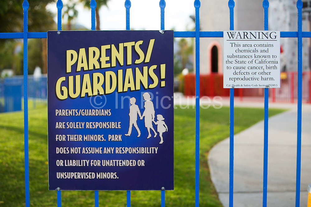 Chemical warning signs in childrens play area in a theme park in Palm Springs California